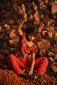 Child working in a brick crushing factory in Bangladesh